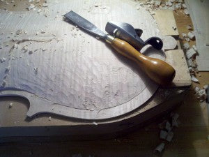 Cello form on a workbench