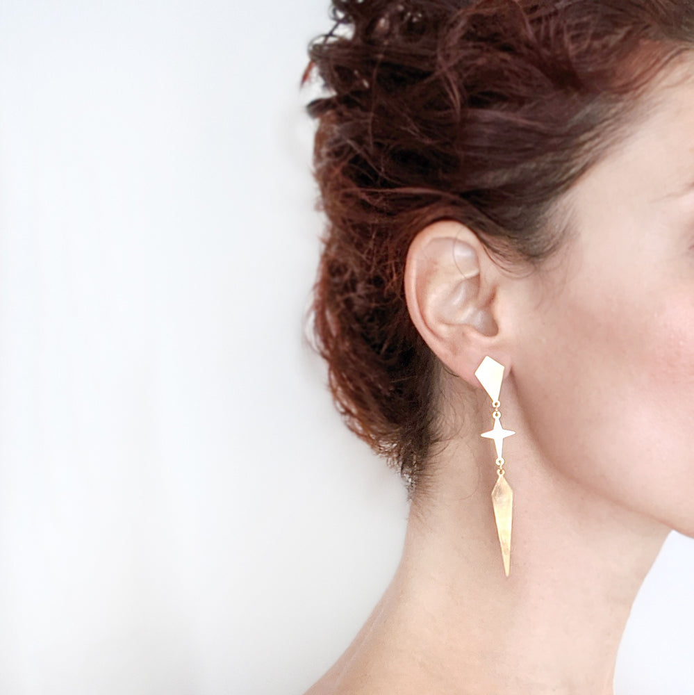Load image into Gallery viewer, Rhombus and star long Twain Earrings in gold on a model