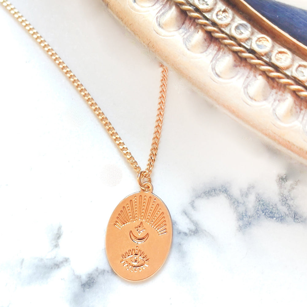 Evil Eye medallion necklace Gold / Silver