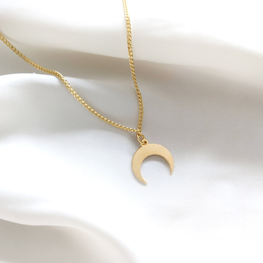 Delicate gold moon charm necklace
