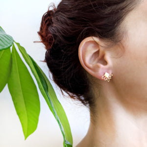 Tiny Lotus Flower studs earrings on a model