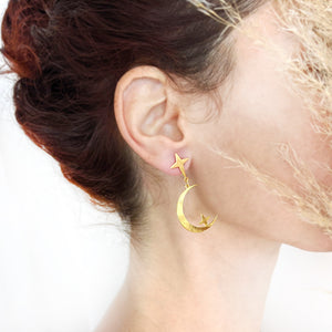 Star and Moon Studs Earrings on a model