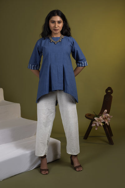 Indigo high-low hem top with white khadi pants