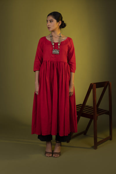Red gathered dress with black pants and dupatta