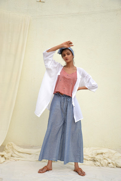 Red Mulmul Strappy Top with White Shirt and Flared Pants