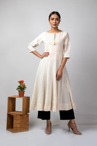off white kalidaar with pin tucks and black thread details