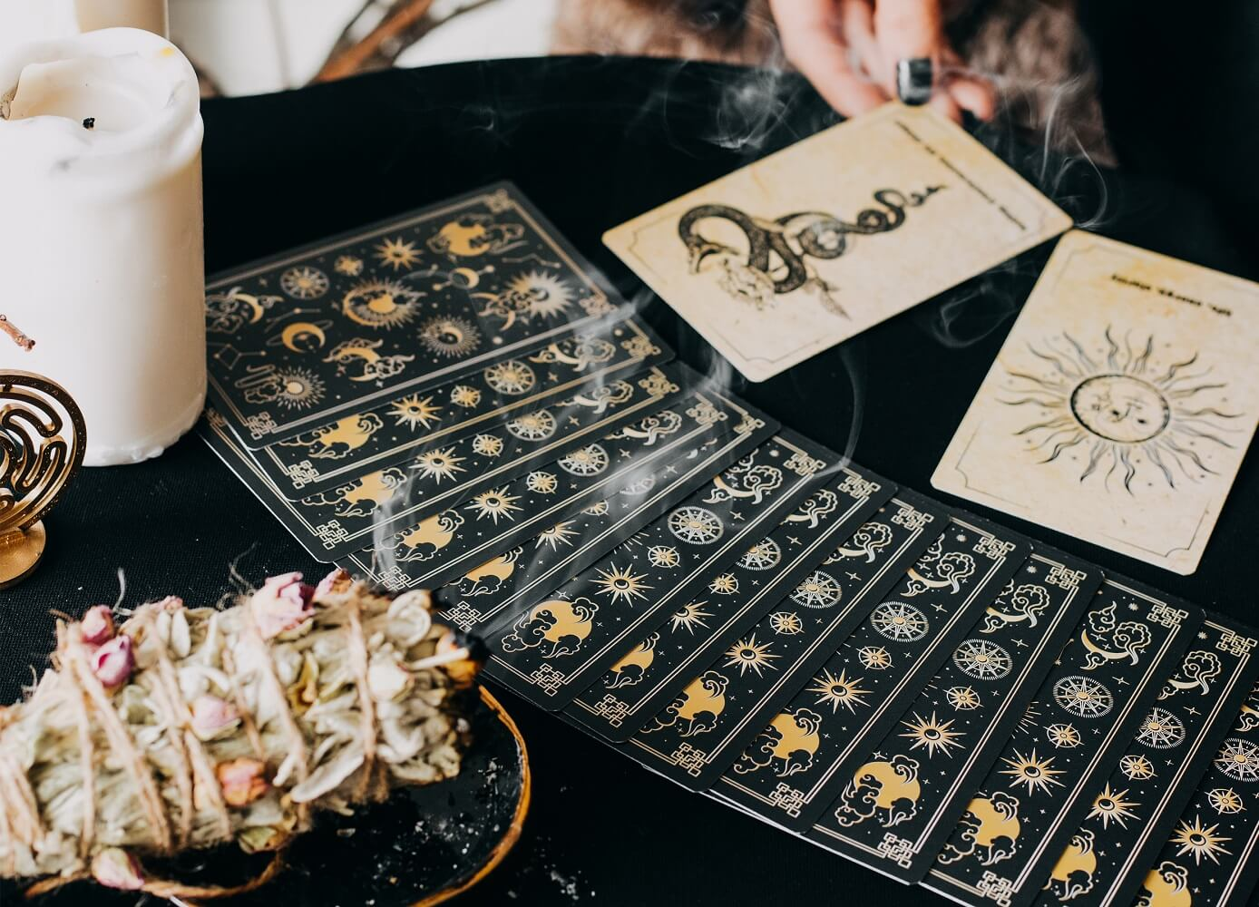 Oracle cards spread out on a table with a black cloth