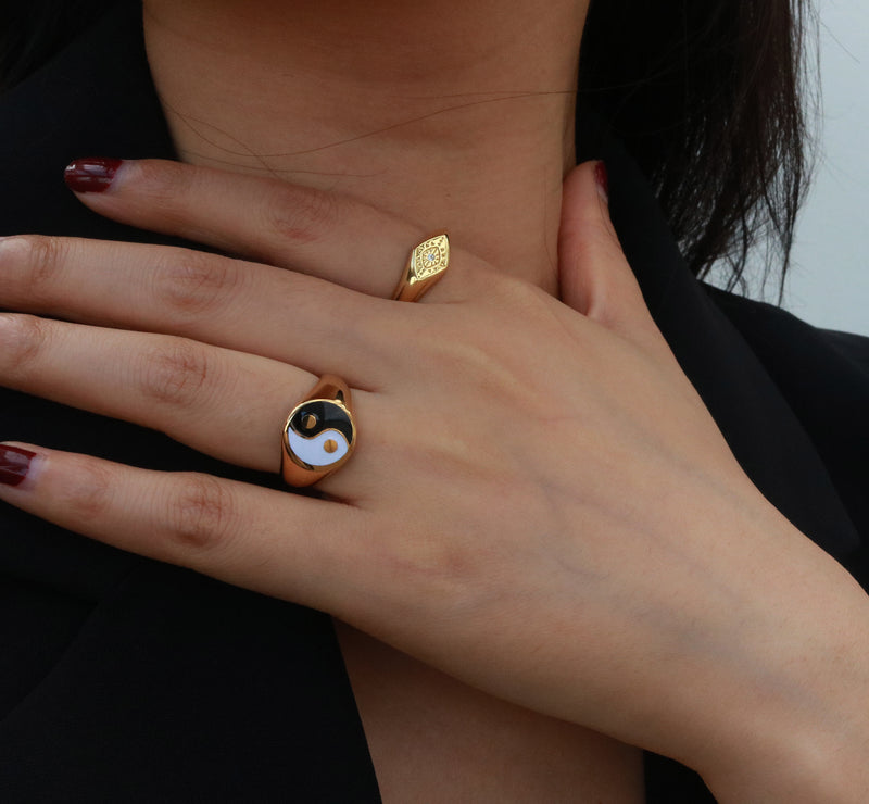 woman wearing gold signet rings