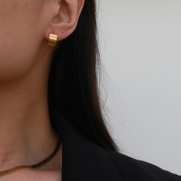 Gold chunky huggie earrings