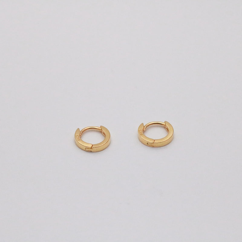 Tiny infinite hoops in 18k gold