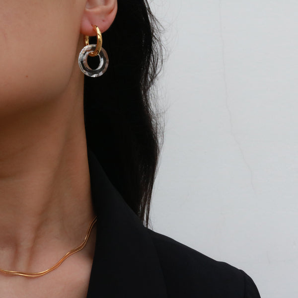 woman wearing glass hoop earring
