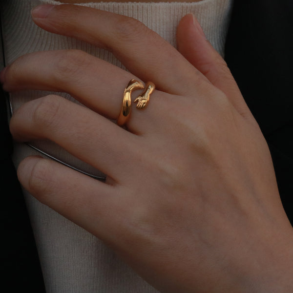 Gold love hug ring