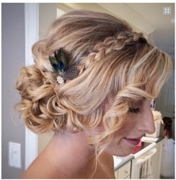 Side swept loose bun with braid and embellished with hair accessory