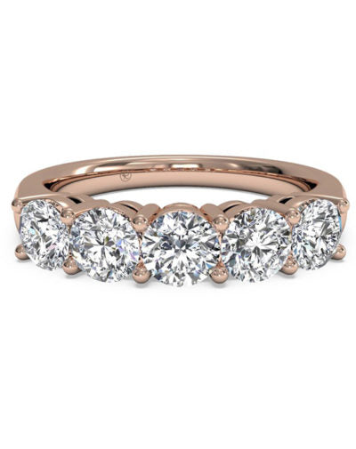Shared prongs create a brilliant row of diamonds
