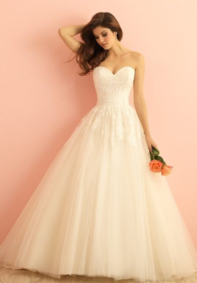 exquisite ballgown is topped with lace appliques