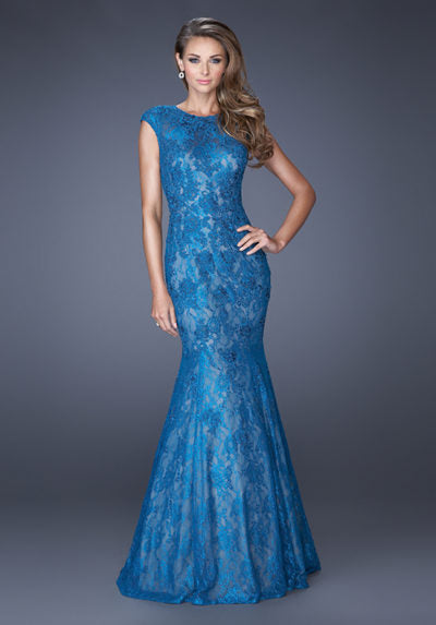 Trumpet style gown with a light lining to accentuate the design of the lace overlay