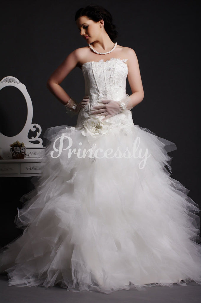 Strapless Lace Appliqued Drop Waist Feathered Ball Gown