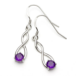 Infinity symbol earrings with purple amethyst on white background