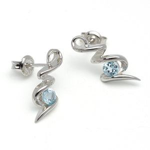 Sky Blue Topaz Silver Squiggle Earrings on White Background