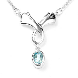 Sterling Silver Blue Topaz Celtic Necklace on White Background