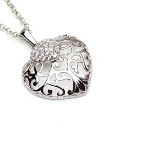 Silver Filigree Heart Pendant with CZ detail on Chain on White Background