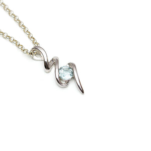 Sky Blue Topaz Silver Squiggle Pendant Diagonally on White Background