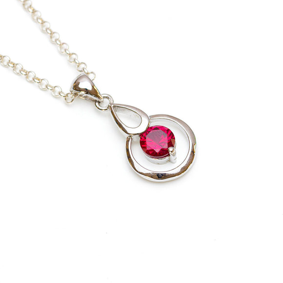 Circular Lab-ruby pendant on white background