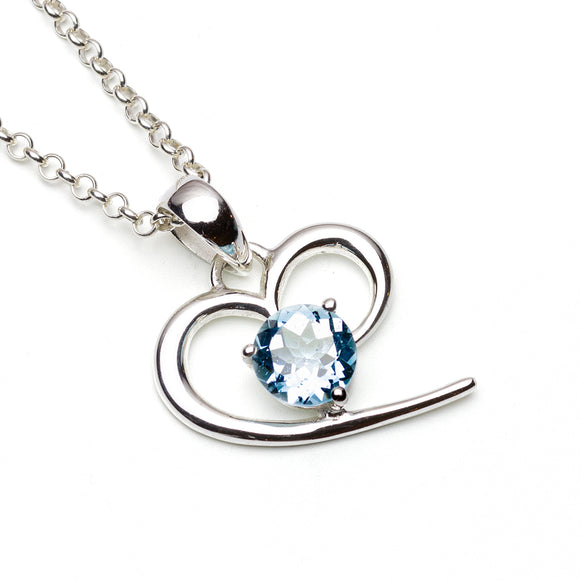 Sky Blue Topa Sterling Silver Heart Pendant on White Background