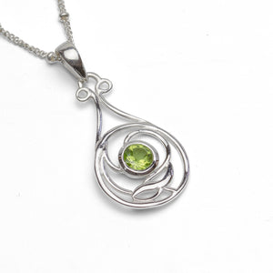 Sterling Silver Peridot Pendant Art Nouveau on White Background