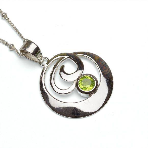 Circular Sterling Silver Peridot Pendant on White Background