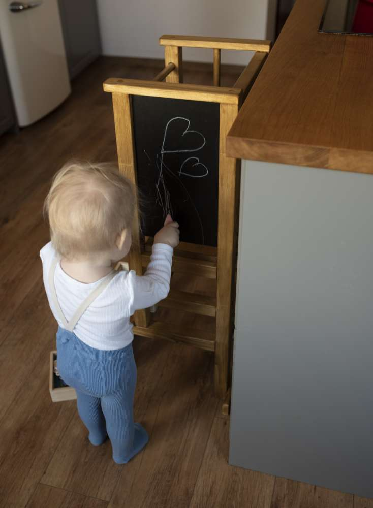 Magnetic built-in chalkboard into a learning tower