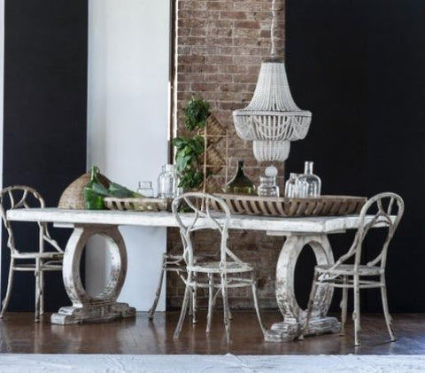 Faux Bois Collection made with iron to look like wood branches dining chairs