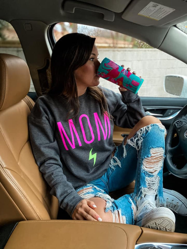 This neon pink and neon yellow MOM graphic is printed on a SUPER SOFT Tultex sweatshirt, unisex sizing. Stay true to size! This one fits slightly longer than our Gildan sweatshirts:)