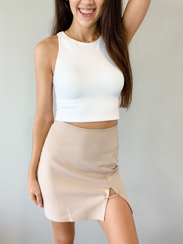 This taupe mini skirt is so fun with a front safety pin detail. Features a back zipper closure. Fits true to size.
