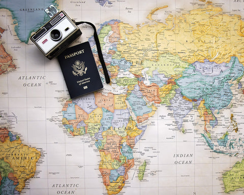 Map With Passport and Camera