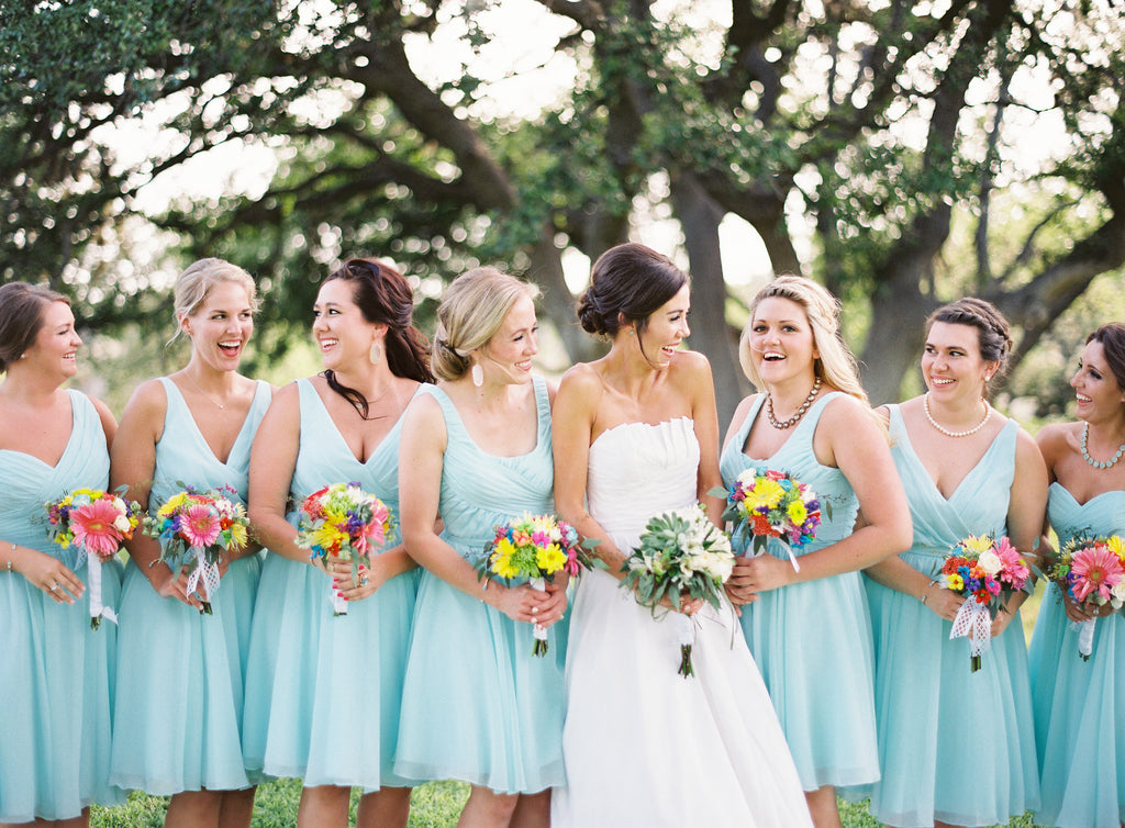Short chiffon mint blue bridesmaid dresses with bright, summer wedding bouquets! | Photo by Kayla Barker Photography | Kennedy Blue
