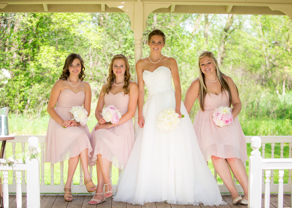 Short strapless blush pink bridesmaid dresses | 11 Pin-Worthy Bridal Parties | Melissa Jopp Photography | Kennedy Blue