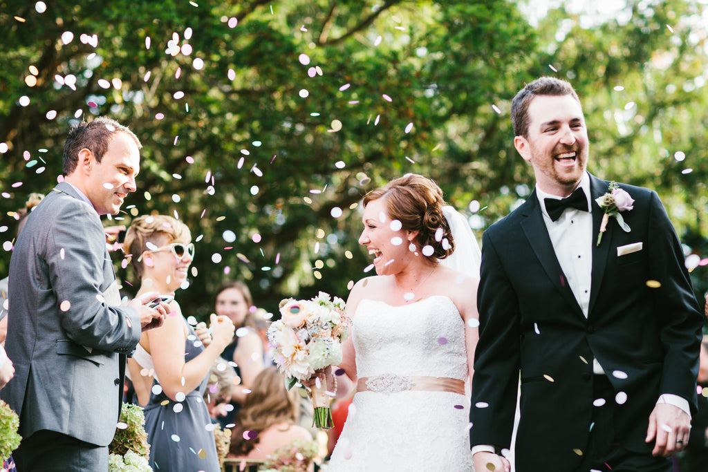 A fun photo of confetti being tossed at the recessional | Photo by Beth Insalaco | Stunning Wedding Photos to Inspire Your Big Day! | Kennedy Blue