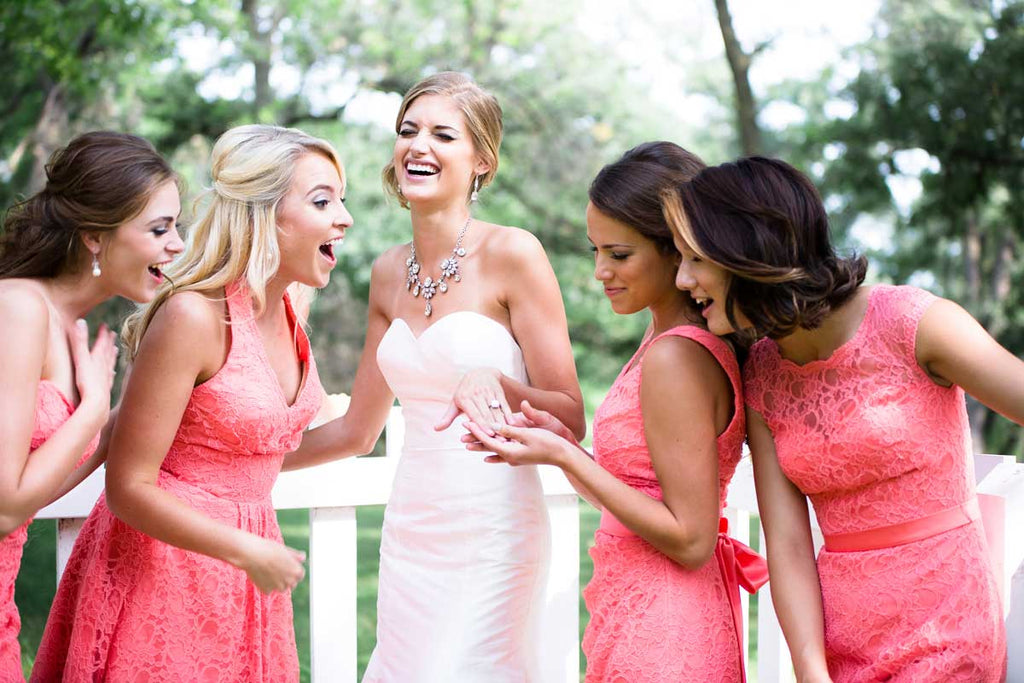 Take a pic with your bridesmaids while showing off your sparkly bling!