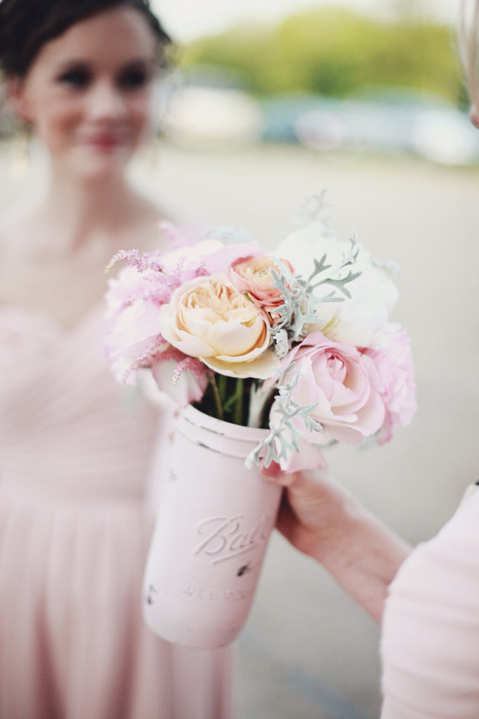 Love these bridesmaid bouquets in pink mason jars! | A Whimsical Gold and Pink Wedding Day