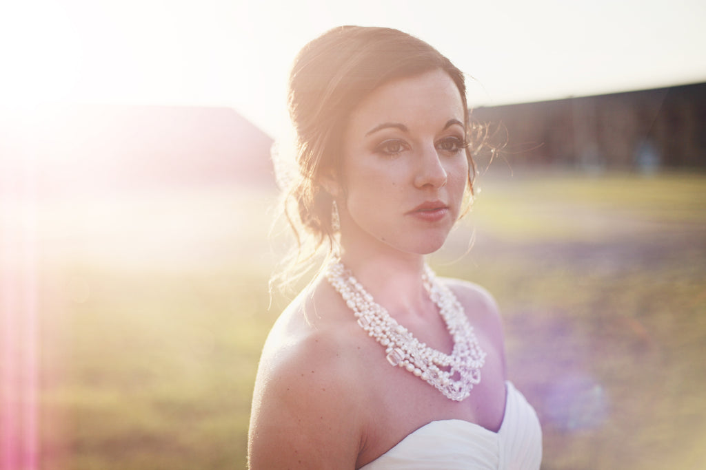 Briana was stunning in her chiffon wedding dress. | A Whimsical Gold and Pink Wedding Day
