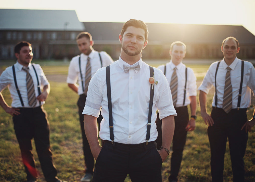 Style the guys in suspenders and a bowtie. | A Whimsical Gold and Pink Wedding Day