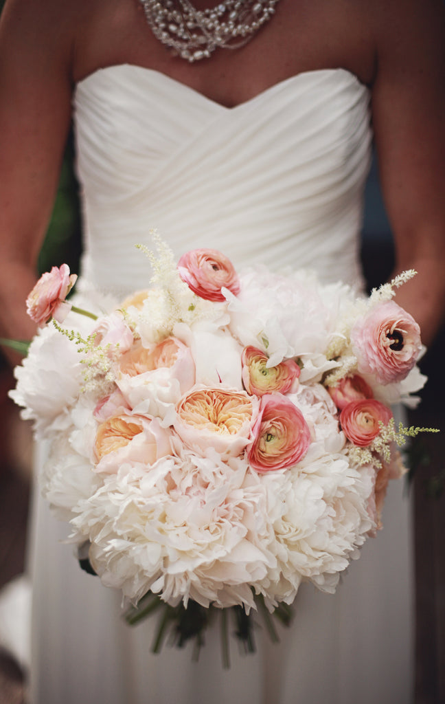 A gorgeous white and pink bridal bouquet for a rustic chic wedding. | A Whimsical Gold and Pink Wedding Day
