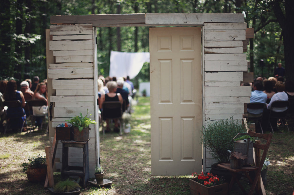 A rustic, wooden door for their ceremony entrance. | A Whimsical Gold and Pink Wedding Day
