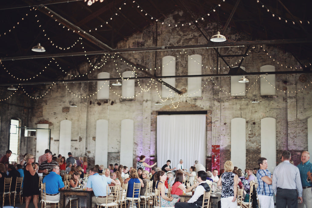 How cool is this rustic, industrial wedding venue? | A Whimsical Gold and Pink Wedding Day