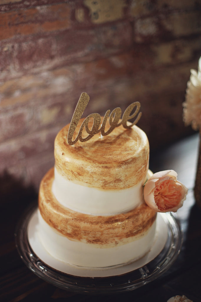 A hand painted, gold wedding cake. | A Whimsical Gold and Pink Wedding Day