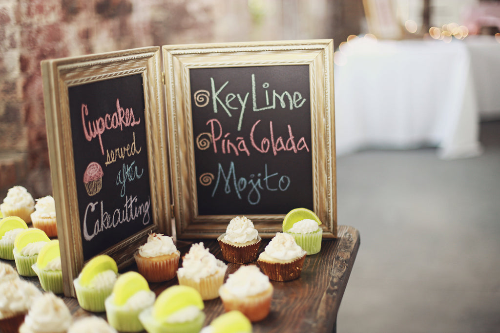The desert table included an assortment of cupcakes. | A Whimsical Gold and Pink Wedding Day
