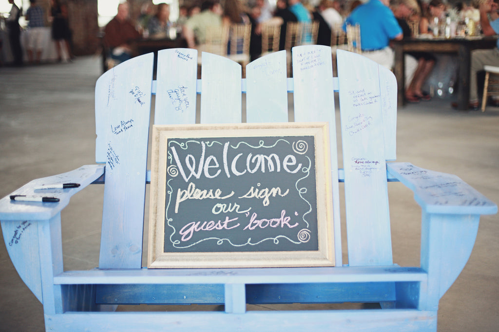 A wooden chair is a unique guestbook idea. | A Whimsical Gold and Pink Wedding Day