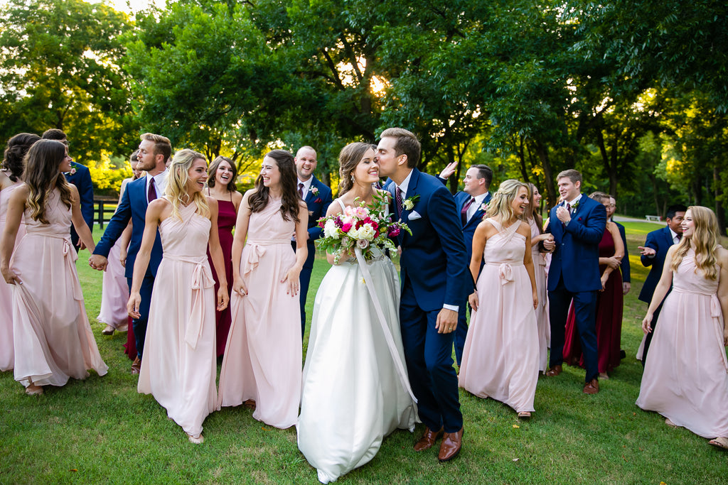 Chase's groomsmen in Navy suits complement Madison's bridesmaids in Blush and Bordeaux perfectly!