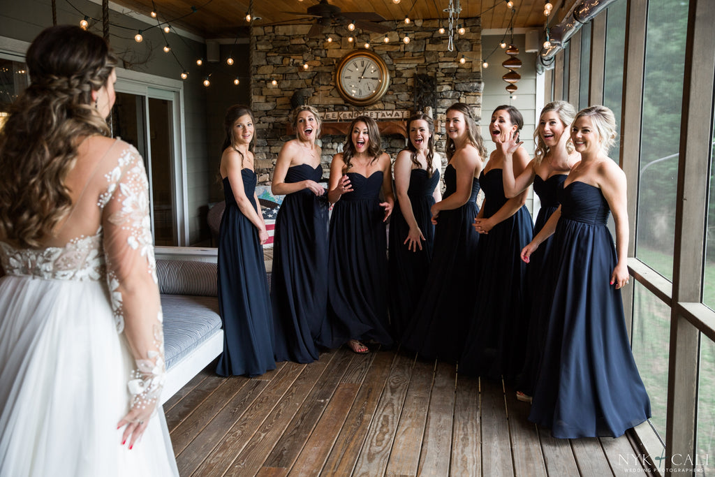 A wedding picture of the bridesmaids' 'first look' of the bride! | Photo by Nyk & Cali Photography | Stunning Wedding Photos to Inspire Your Big Day! | Kennedy Blue